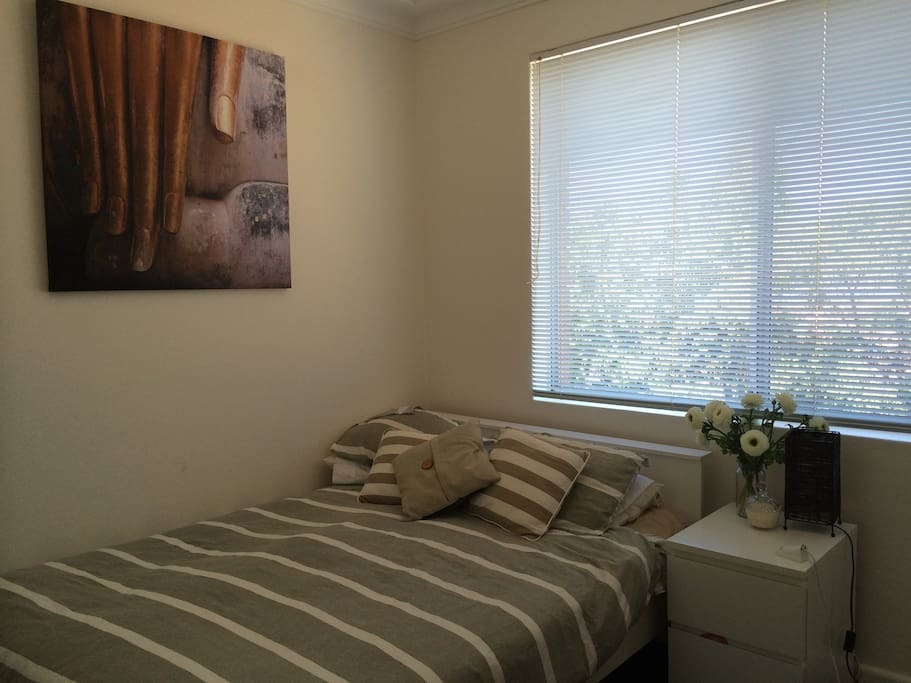 Bedroom 2 features double bed, desk, bedside table, TV and DVD player