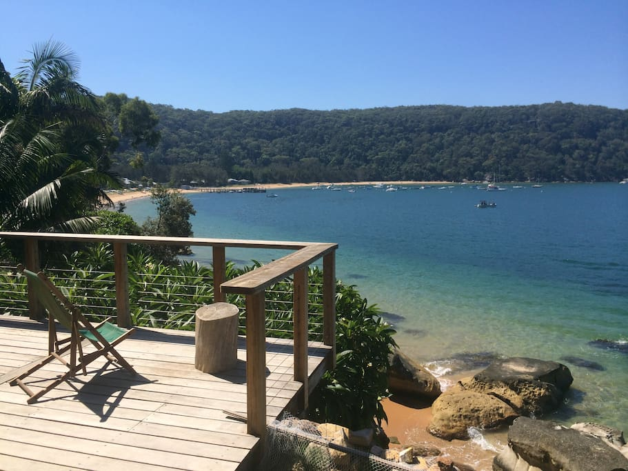 Relax in the sun on the deck with views to Pittwater, Barrenjoey Headland and beautiful Mackerel Beach itself