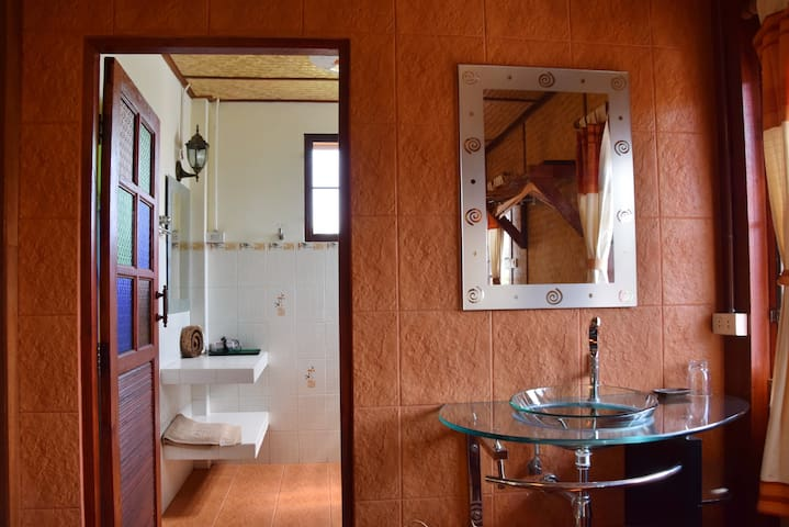 room 1 with a comfortable walk- in- bath plus hand wash basin in living room