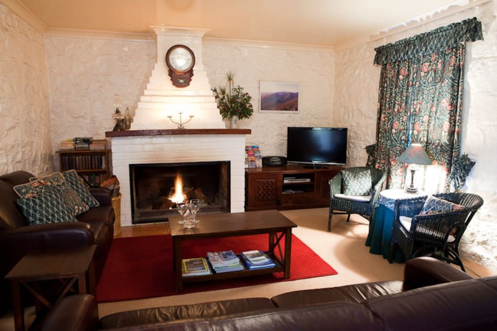 Stoneycroft Cottages sitting room with open fire.