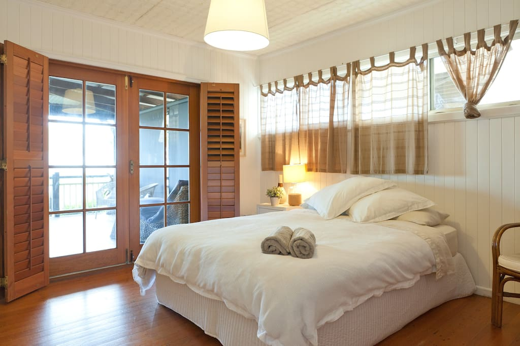 Main room - Queen Bed with views to Moreton Bay