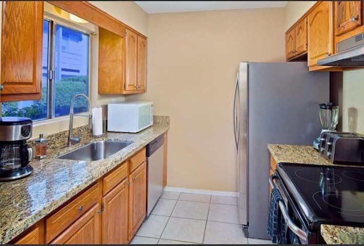 Kitchen with all utensils and coffee maker also large pantry, microwave, refrigerator and oven.