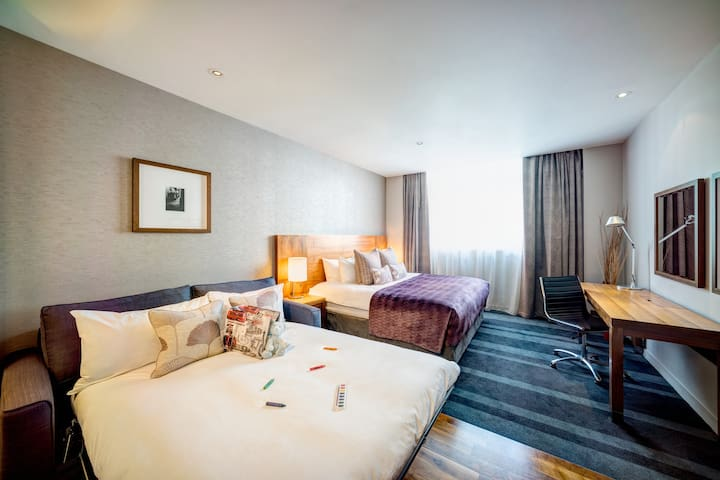 Deluxe family room in this modern four-star hotel near Tower of London.