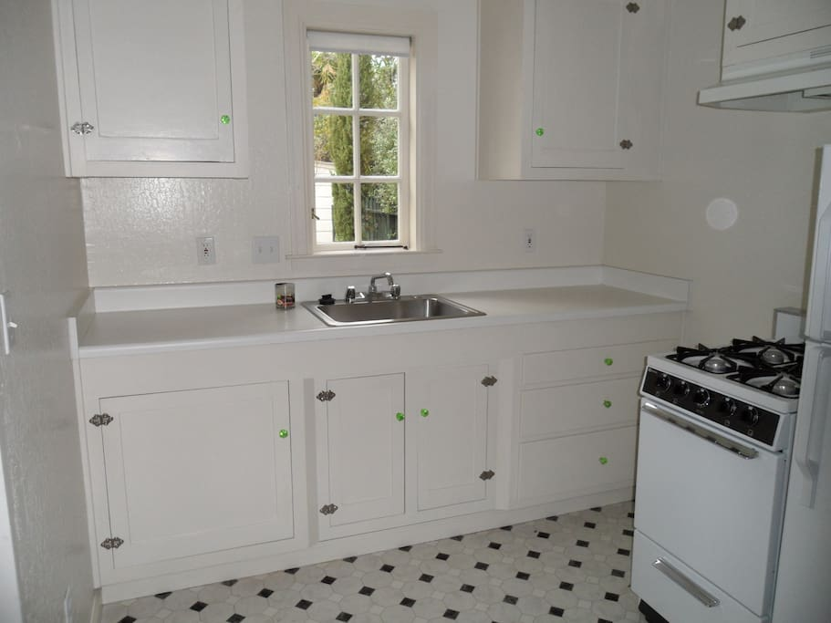 kitchen with gas stove and refrigerator