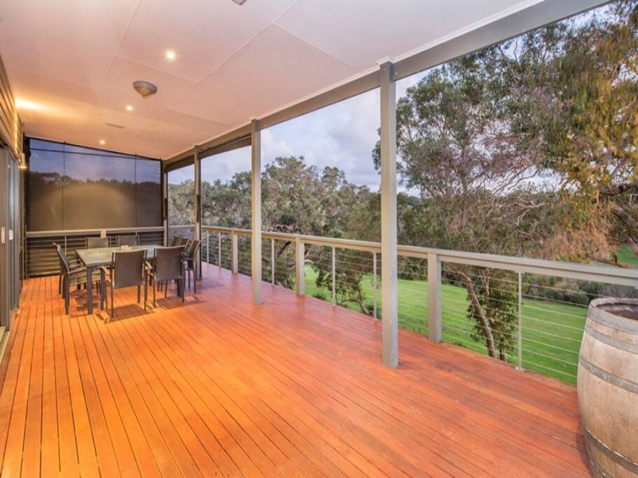 Expansive balcony with BBQ and dining table