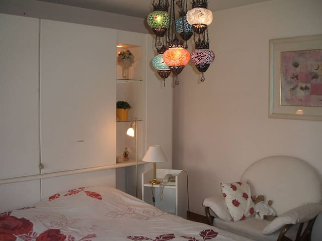 Nice quiet romantic room with terrace and view on the garden