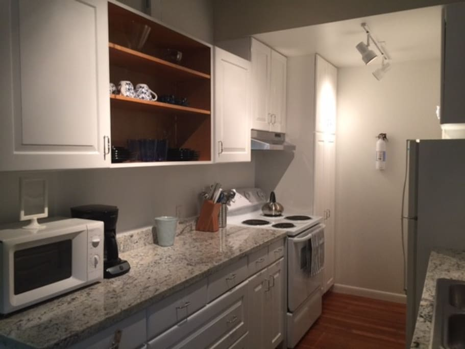 Gorgeous granite. Ample counter and cabinet space. Microwave and coffee maker