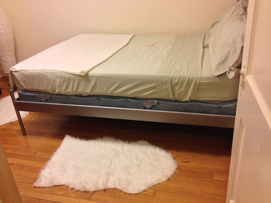 The full-sized bed is comfortable and accommodates 1 or 2 guests.