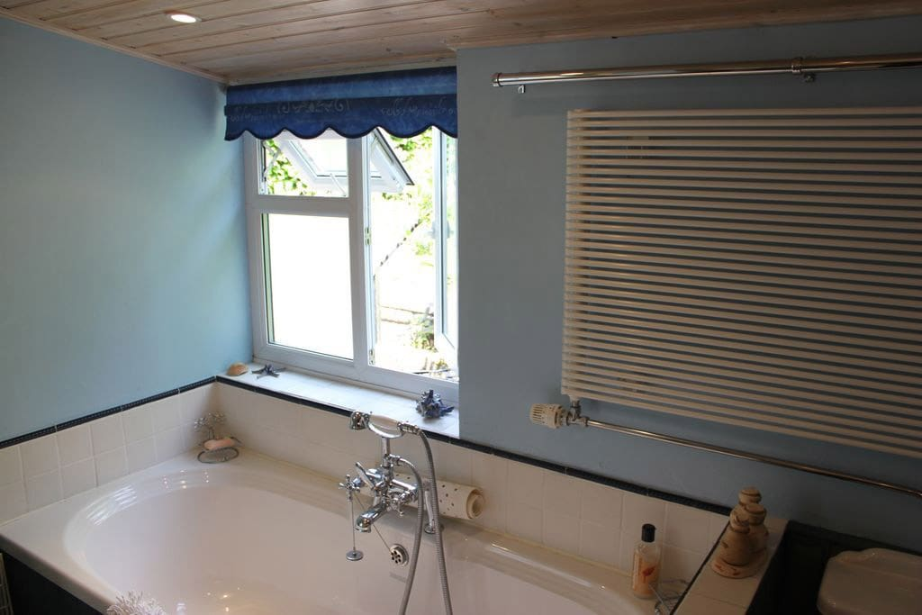 Spacious bathroom with walk in power shower