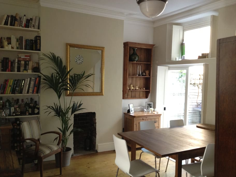 Dining room.  The dining table seats up to ten people. There is an exit to the garden.