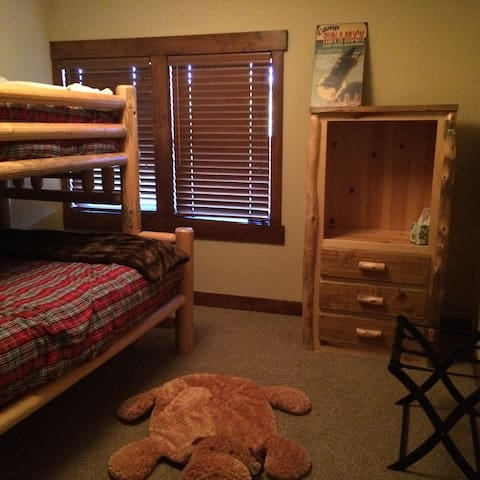 Bunk bed room with full size bed and twin bed, perfect for kids.