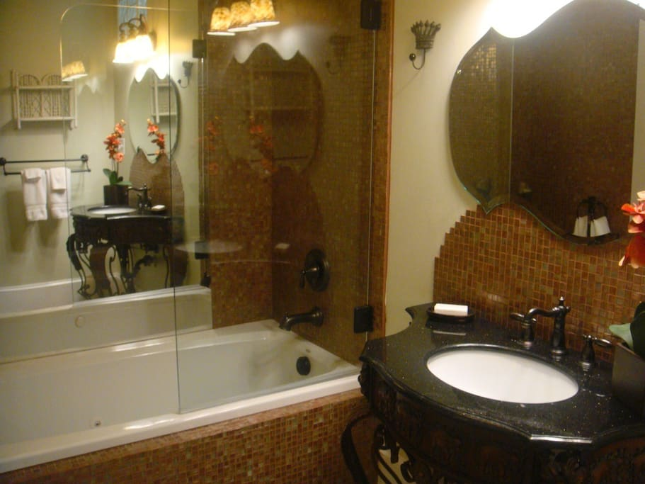 There is a jetted tub and shower in this bath as well as an additional second sink which cannot be seen in this photo.