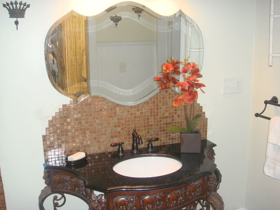 This is a view of the imported hand carved sink from India with granite top and glass tile back splash.