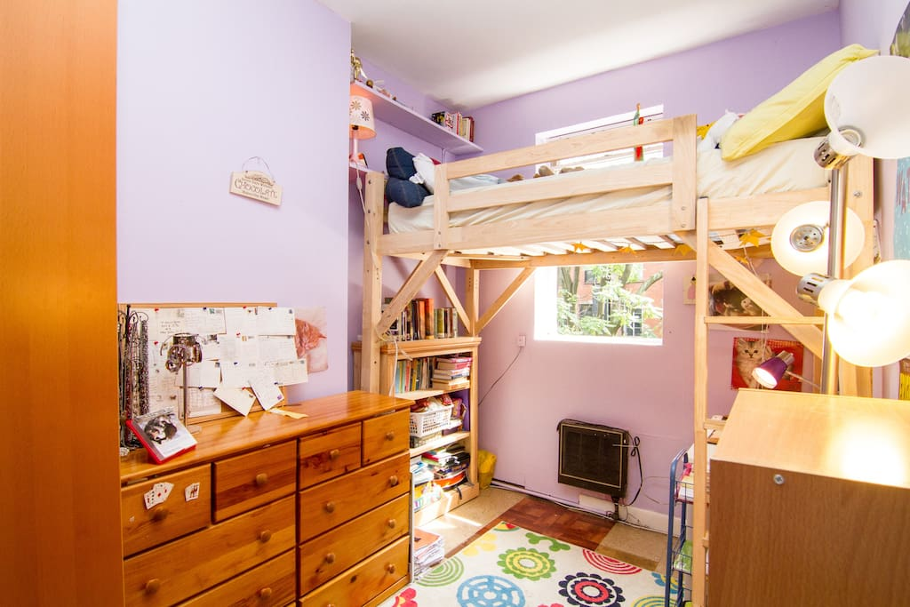 Comfy loft bed and lots of books to read.