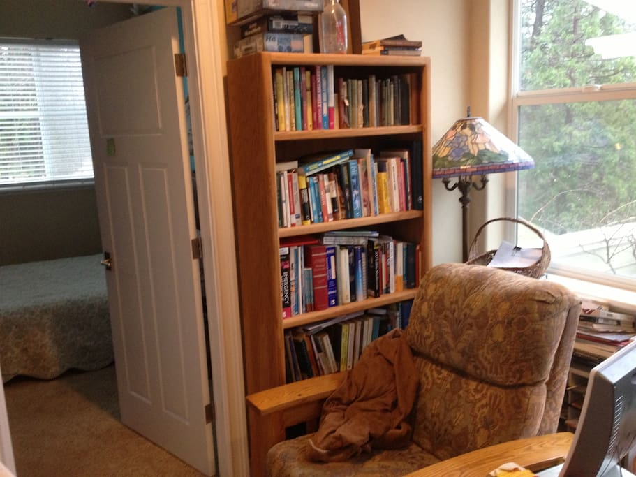 Recliner chair on landing for reading.  Hot tub on deck behind chair.