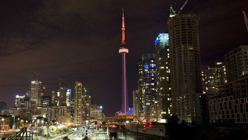 See the Famous CN Tower all lit up while lying in bed!