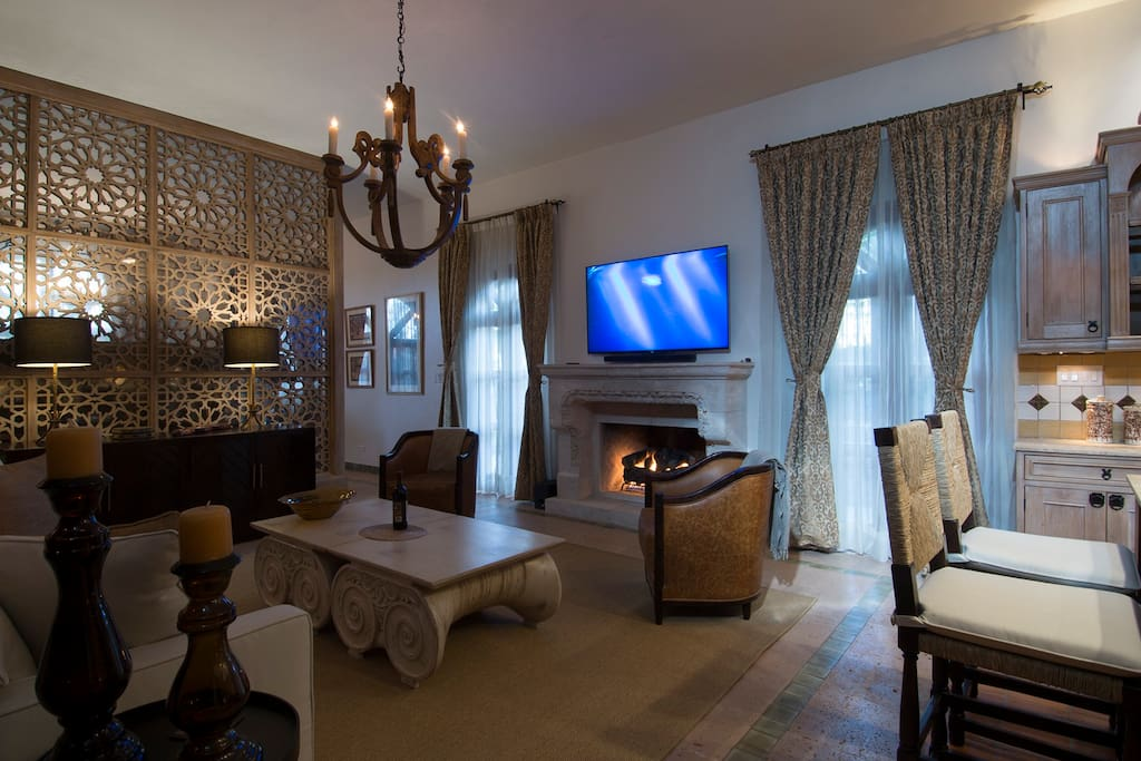 Comfortable seating and a view of the fireplace while watching a movie on NetFlixs