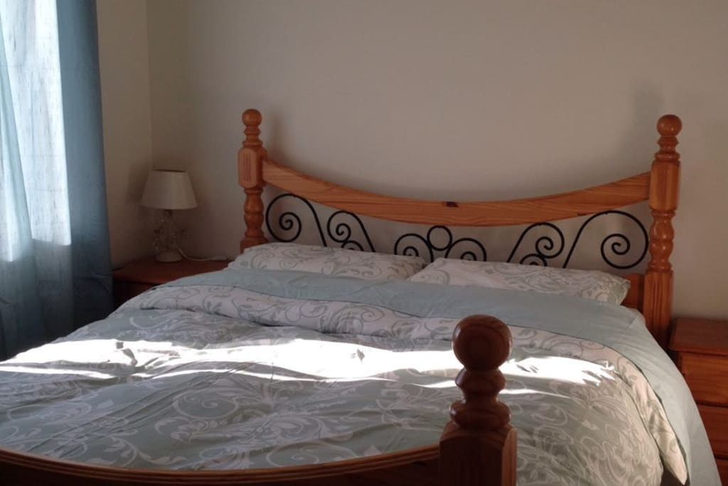Large King size comfortable bed with full wardrobe space with hangers.