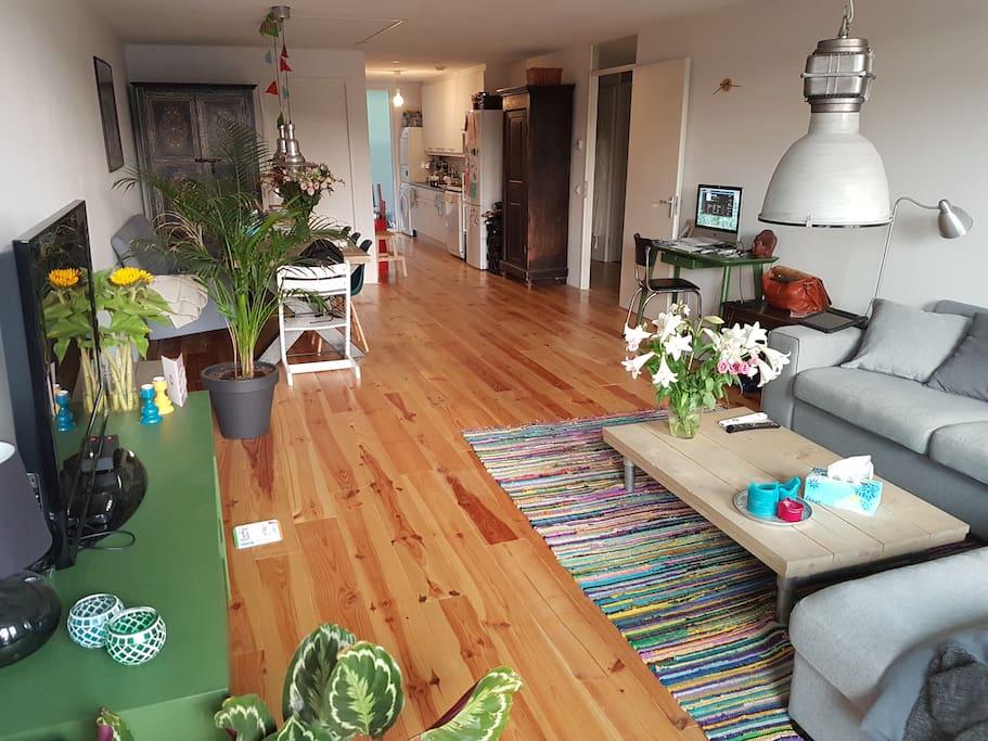Livingroom from balcony door with kitchen in the back