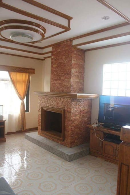 sala w/ fireplace and 50 inch smart tv and x-box