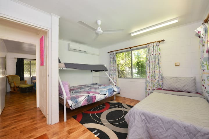 Bedroom 3 - 2 singles and double bed.
