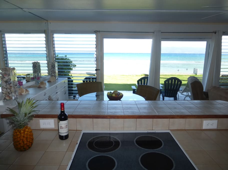 Gaze out at the ocean while cooking your meals