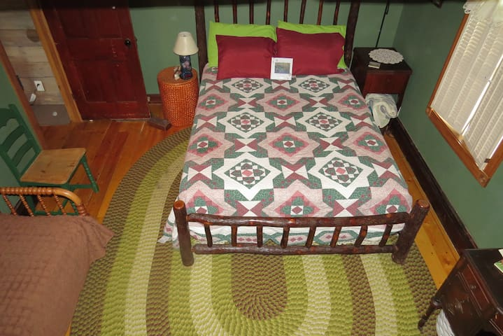 This is your queen size bed in the bedroom. With a hired hand bed as well (longer and thinner).