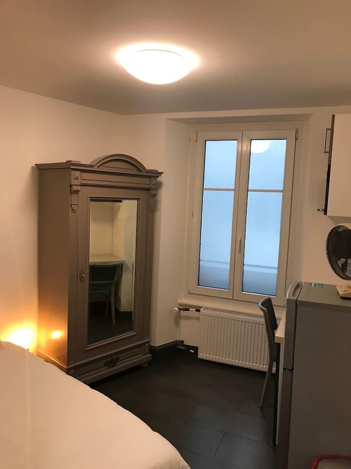 Details of the room: Single bed Closet Micro-wave Fan Desk Chair Fridge Freezer