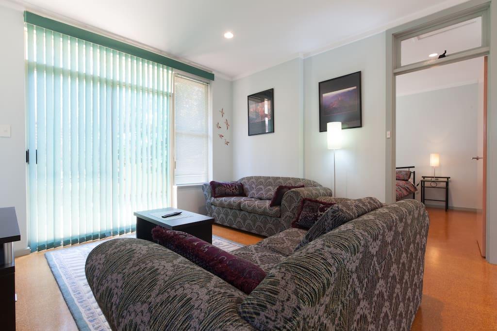 large loungeroom with door to bedroom