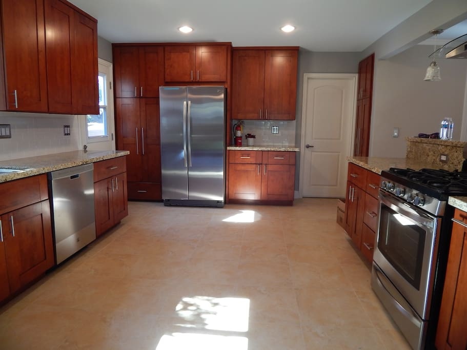 Spacious, new cherry cabinets, granite counter tops and all new appliances.