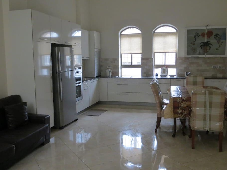 High Ceiling Well Equipped Kitchen
