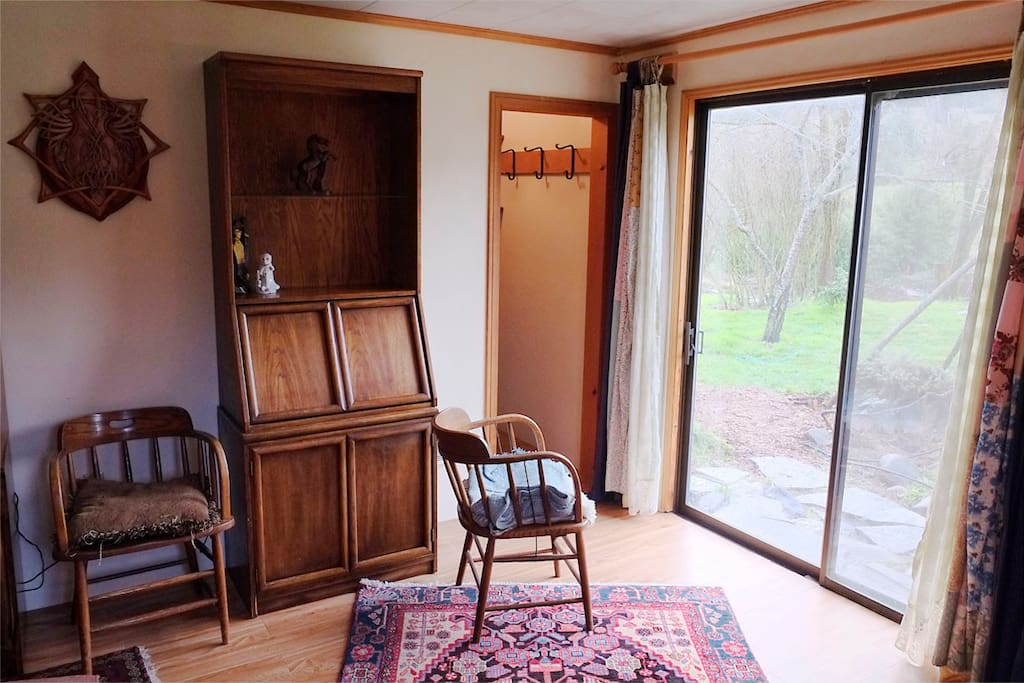 The bedroom has a walk in closet and a sliding glass door opening into the gardens on the south side of the house.