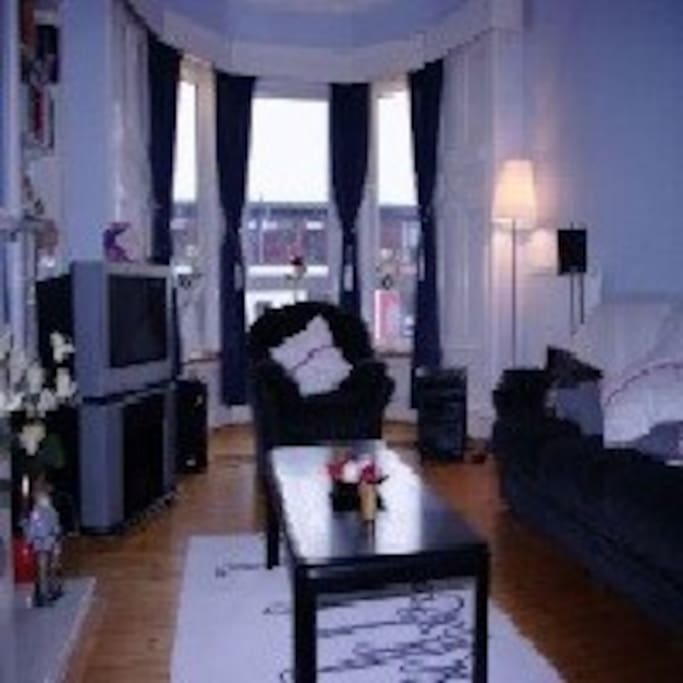 Large spacious lounge, with big bay windows.
