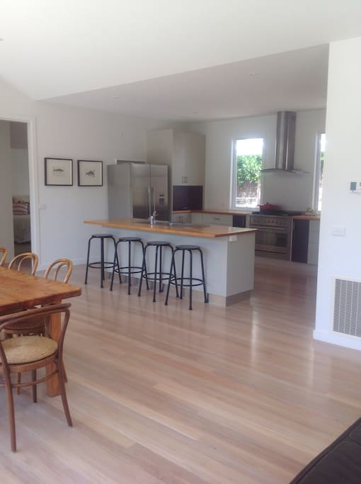 Large open plan kitchen with easy access to dining area
