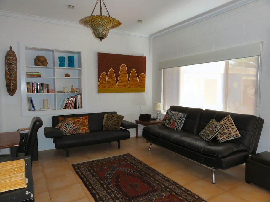 Open plan lounge area with sofa bed...