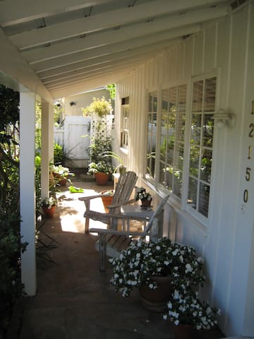 The front porch has two semi-secluded adirondack chairs outside the master bedroom; great place for morning coffee and newspaper