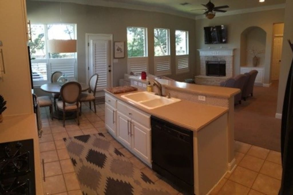 Another view of downstairs kitchen and living area.