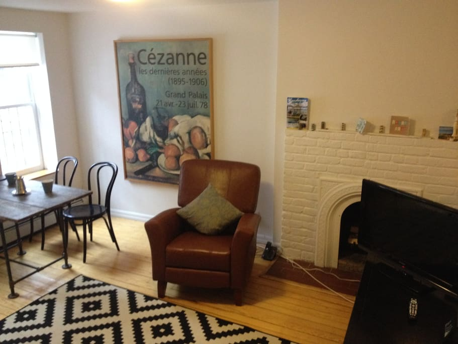 The apartment receives incredible light. Enjoy it while you perch on the rocking chair next to the fireplace.
