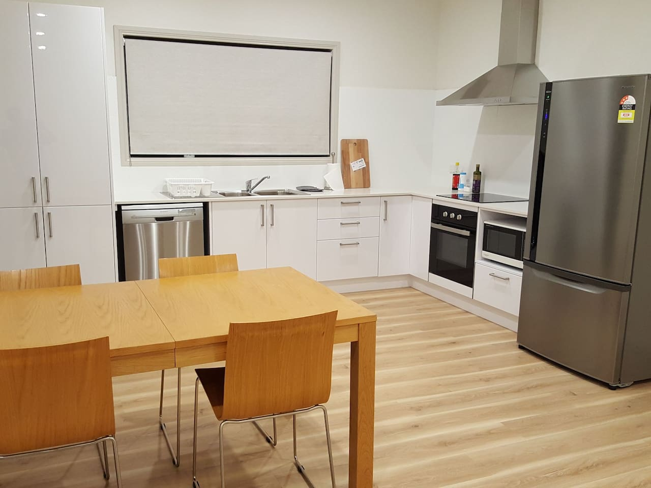 kitchen with induction cooktop, oven and dishwasher
