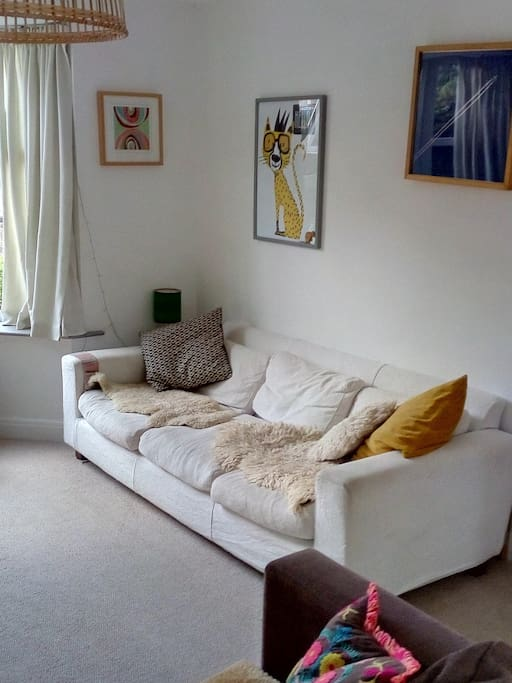 Adjoining sitting room with two sofas and television