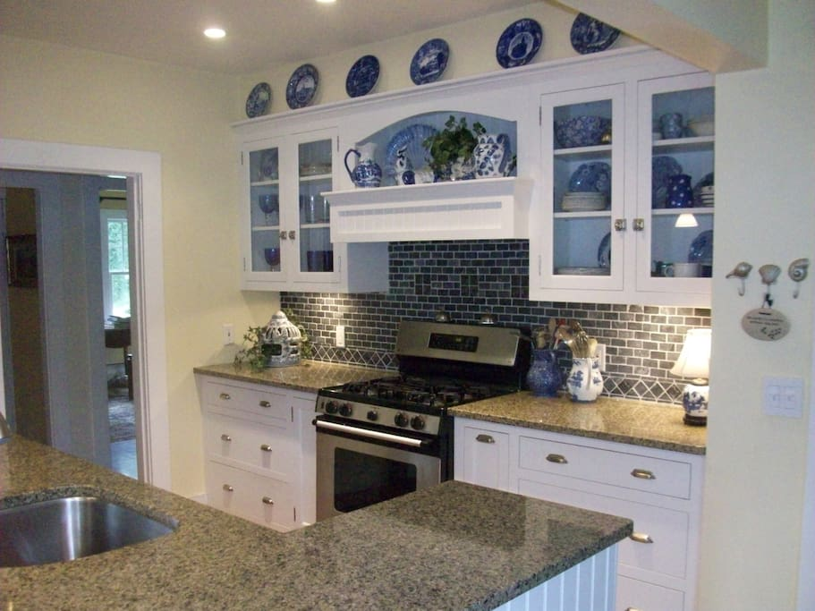 Eat in kitchen with granite counters and stainless steel appliances.