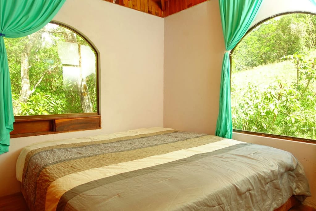 Private double occupancy room with King size bed and beautiful views of the green hills.