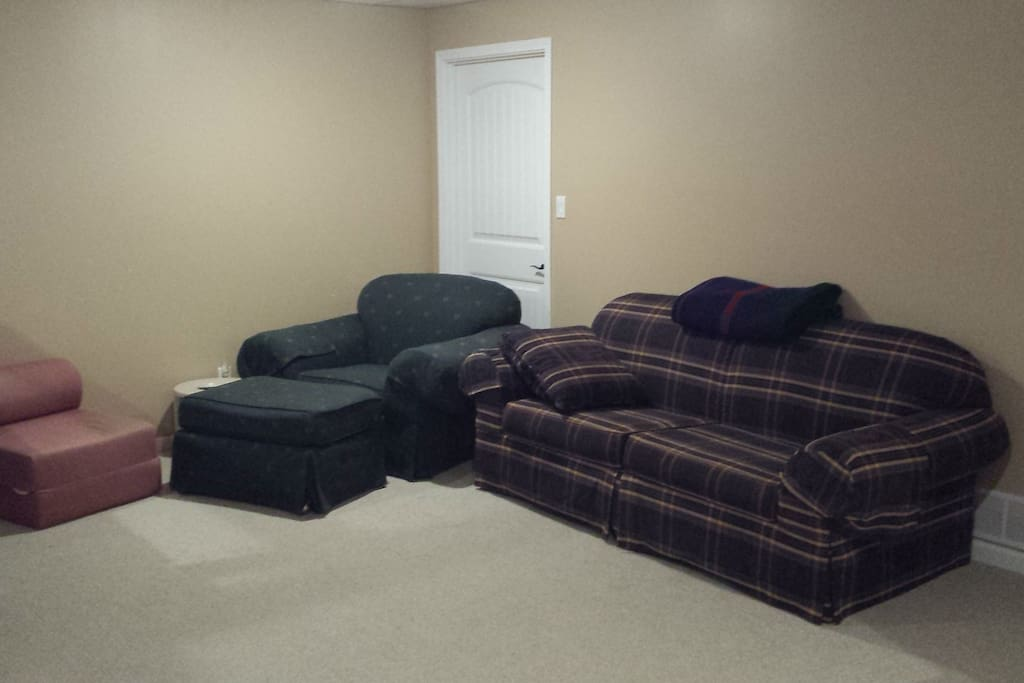 The main living area offers the comfort of a couch, chair and other amenities.