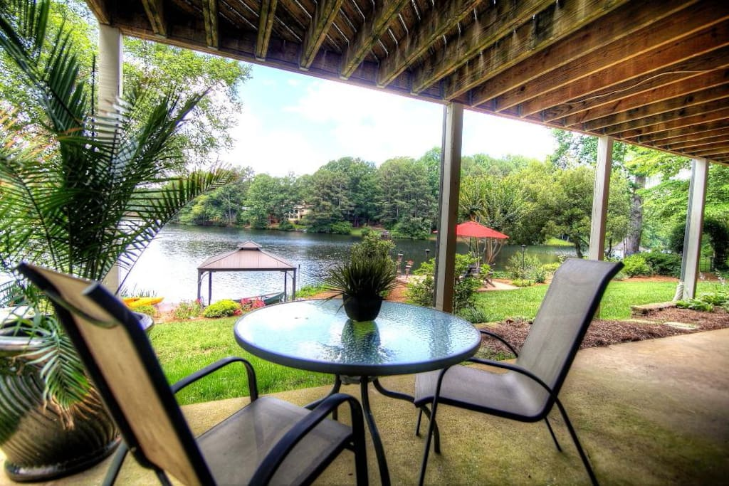Enjoy morning coffee and evening cocktails on this patio directly outside your bedroom ...while enjoying the lake.