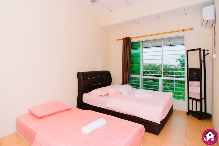Second bedroom - Queen size bed and single bed. Have air-conditioning, ceiling fan, mirror, alarm clock and bed side table.