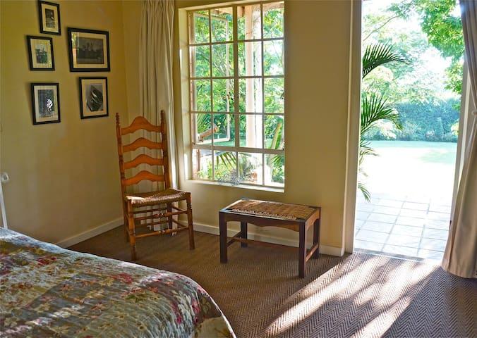 view from bedroom onto verandah
