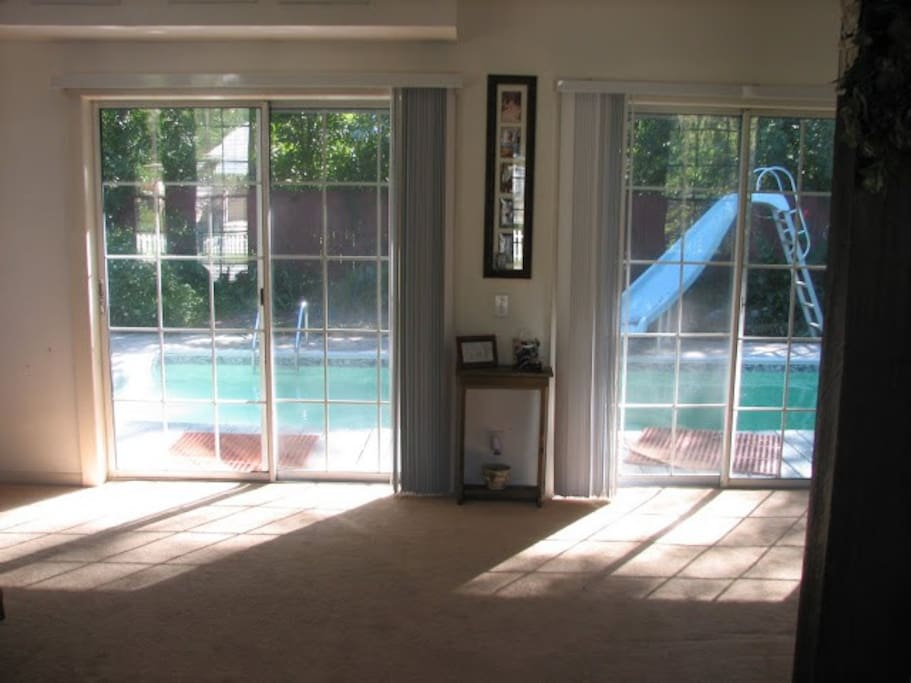 In ground pool and slide off the family room.