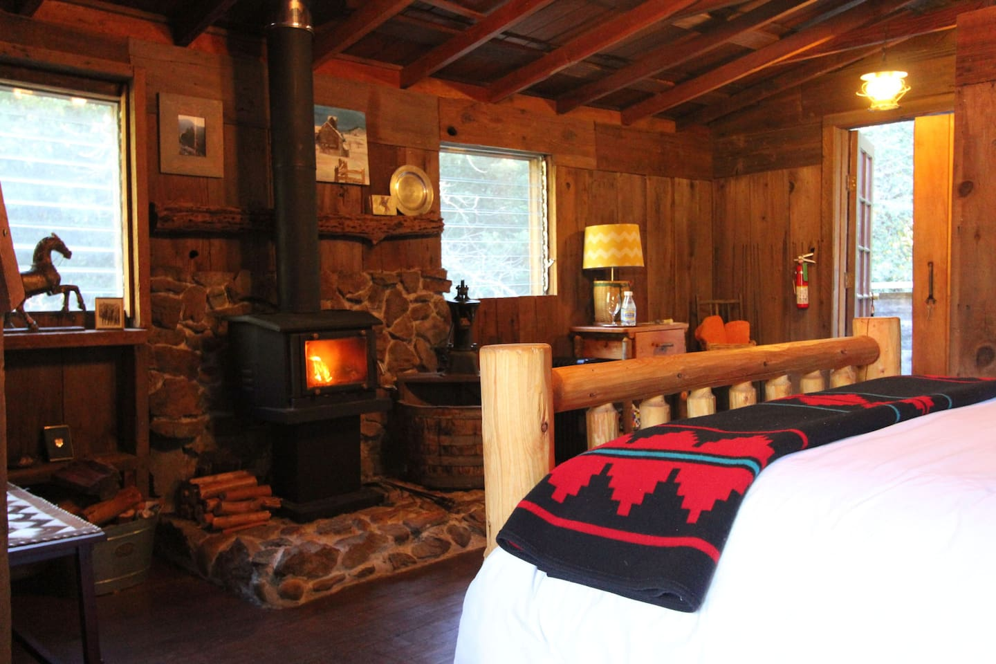 A fireplace graces the rustic room