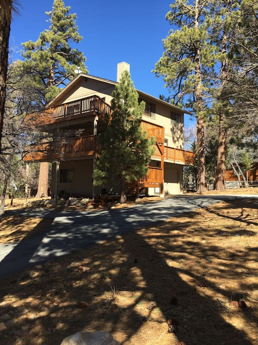 Enjoy private vacation time and ski slope views from our spacious  three story Moonridge home with two levels of wrap around decks, porch swing, and outdoor fire pit.