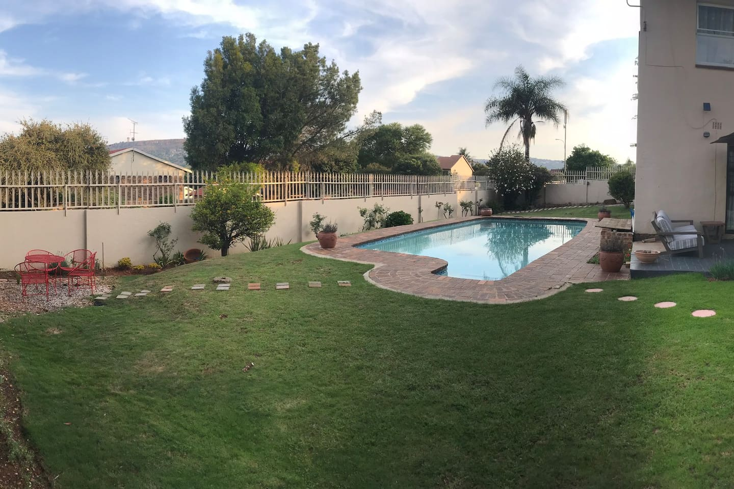 Spacious garden with comfortable patio furniture and pool for your private use